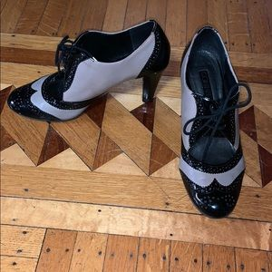 Connie Wing Tip Pumps
